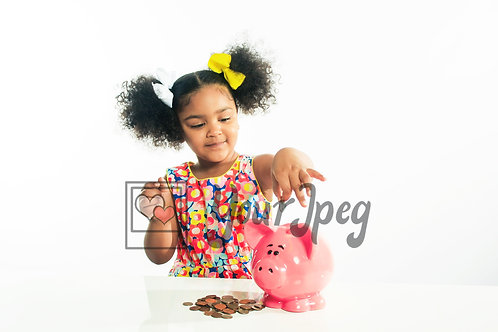 Girl putting a coin in piggy bank