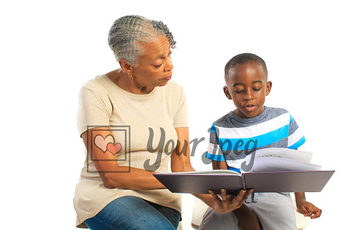Older woman reading book to boy 1
