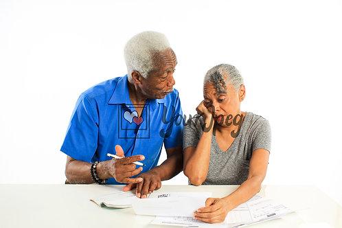 Senior Grandpa and Grandma Looking At Bills With Worry