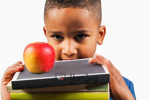 Boy holding Books with an apple on top