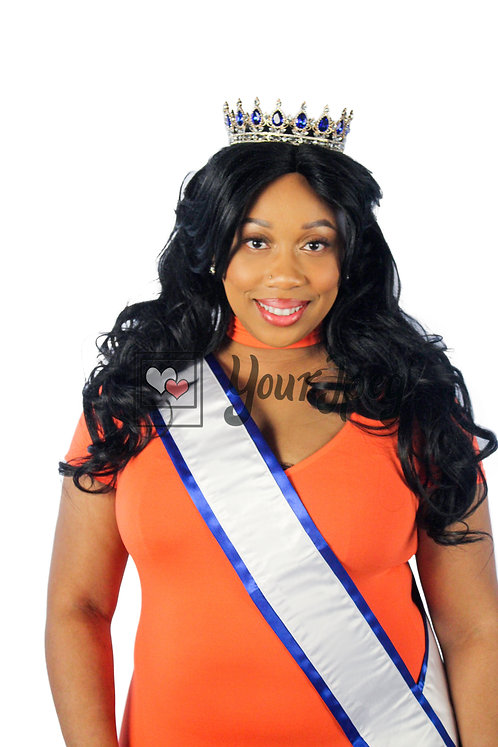 Big and bold queen wearing a sash