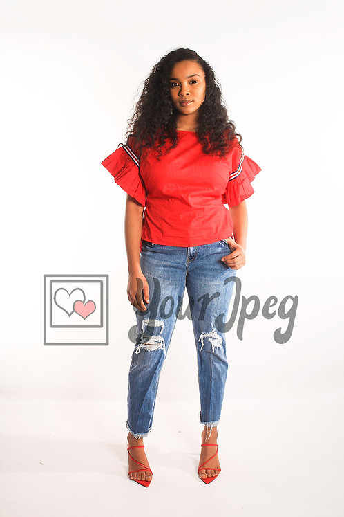 Woman with red top standing