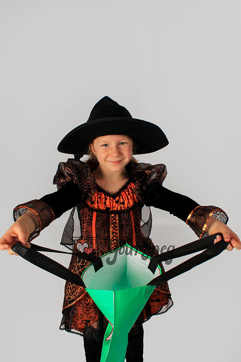Young Girl in Halloween Costume with trick or treat bag