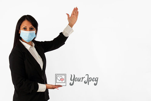 Woman In Suit Wearing Mask Demonstrating To Her Left Side