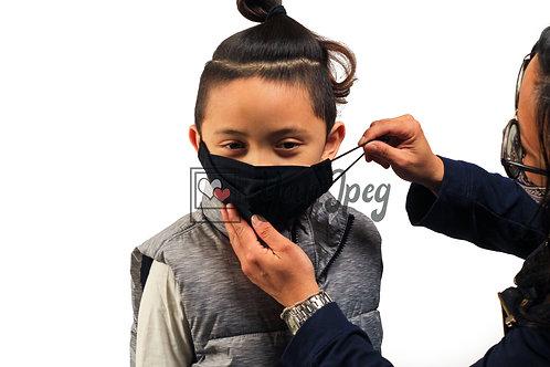 Woman Putting Black Mask On Boy #2