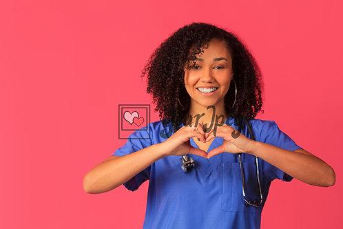 Female Nurse In Scrubs Holding Up Heart Symbol
