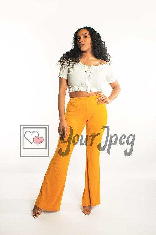 Woman posing wearing yellow pants