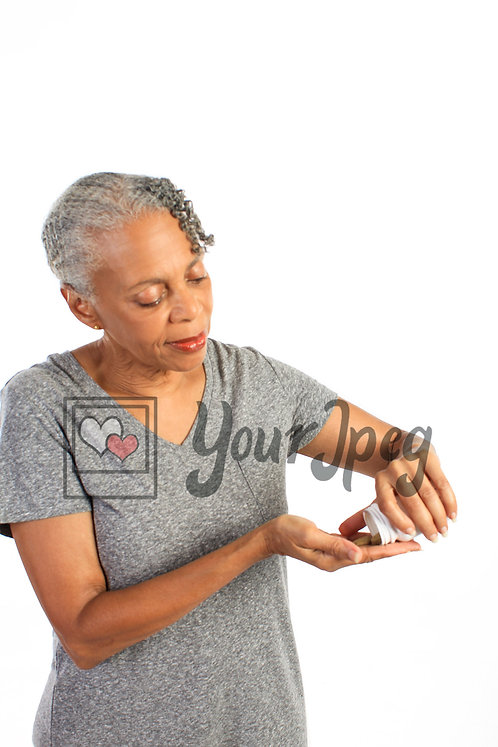Woman pouring vitamins in hand