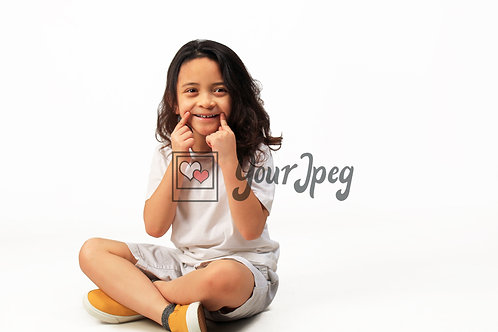 Boy Smiling While having index fingers on  corners of mouth