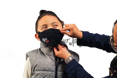 Woman Putting Black Mask On Boy #3