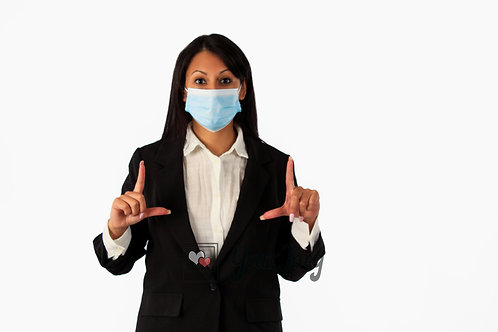 Woman In Suit Wearing Mask Holding Up L Shape
