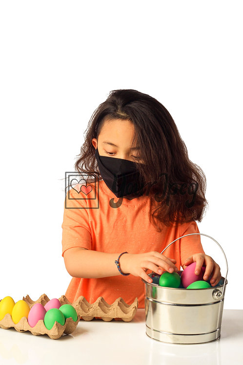 Girl Playing With Easter Eggs While Wearing Black Mask #2