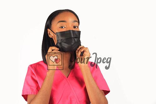Female Nurse Adjusting Black Face Mask At Chin