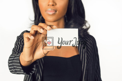 Woman In Suit Holding Up White Card