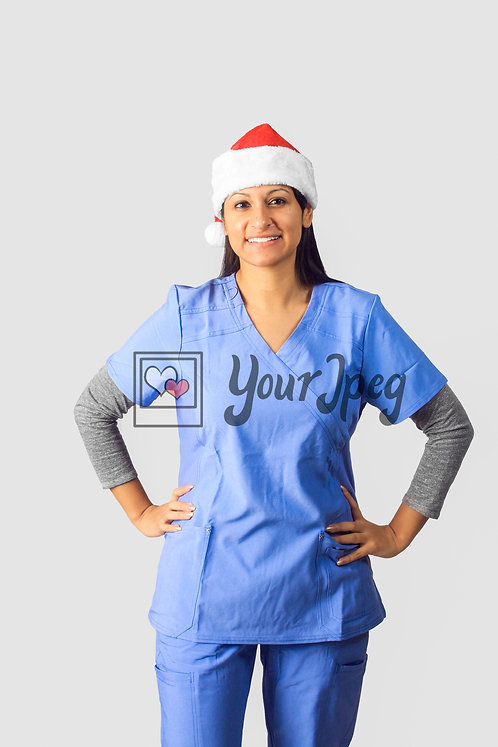Female Nurse Wearing Christmas Hat With Hands On Hip