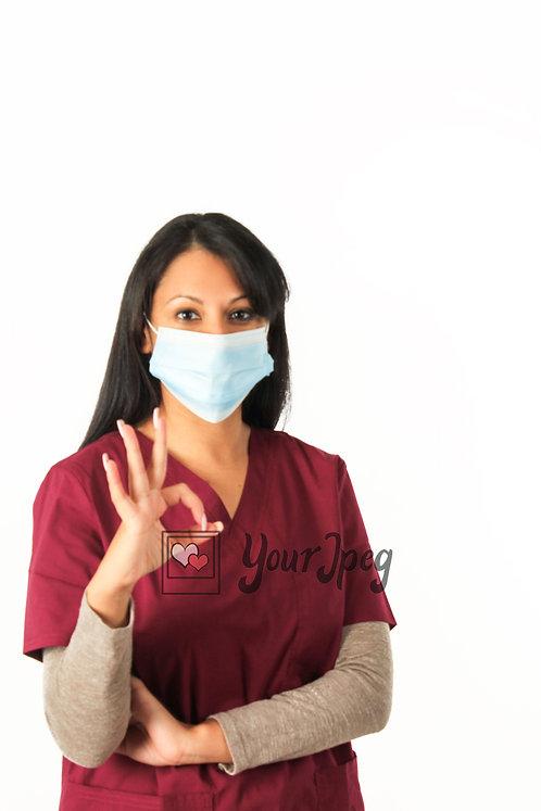 Female Nurse With Mask Holding Up Okay Hand Symbol Close Up