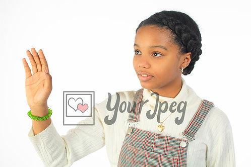 Tween girl holding up hand