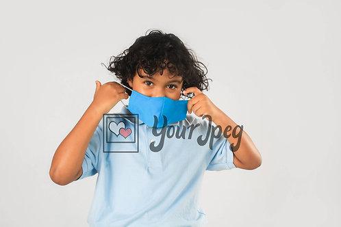Boy Putting On Mask