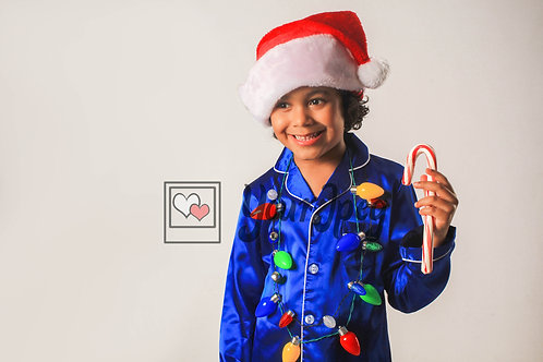 Boy Wearing Christmas Hat And Lights While Holding Candy Cane #2