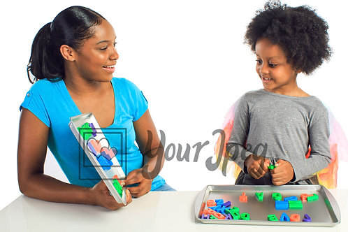 Woman and child playing with alphabet letters