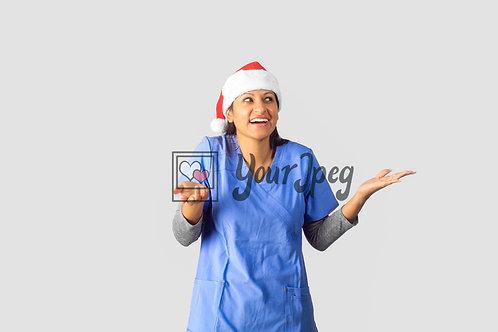 Female Nurse Wearing Christmas Hat With Shoulders Raised