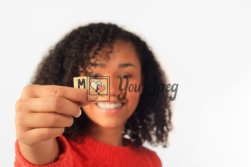 """Woman Holding Up the word """"me"""" using wooden letters"""