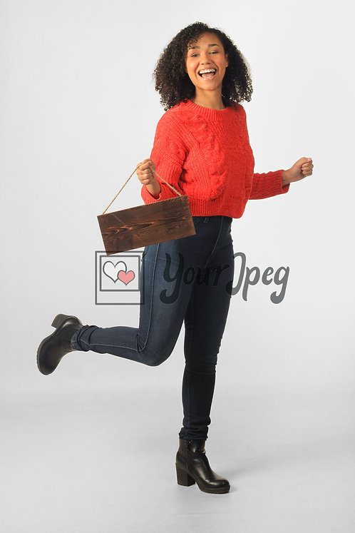 Woman Holding Up Wood Board While Kicking Foot