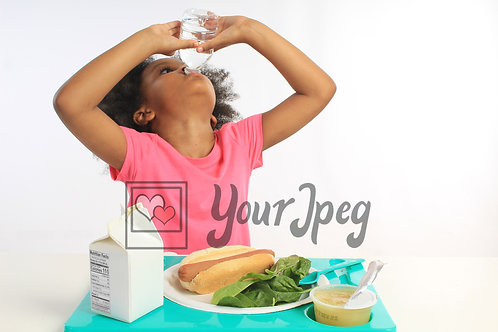 Girl drinking water at lunchtime