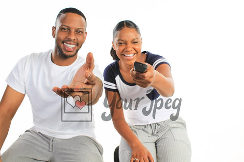 Couple pointing at TV screen