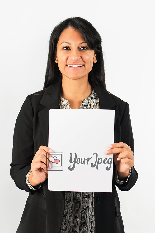Woman In Suit Holding Up Blank Paper