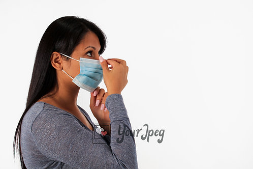 Woman Adjusting Mask Nose Area Side View