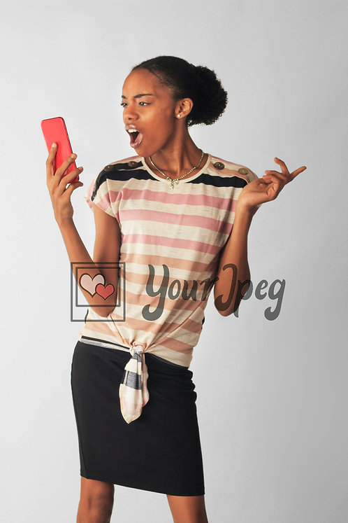 Woman Looking Surprised While Looking At Phone