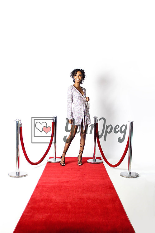 Woman Looking Away While Posing On Red Carpet