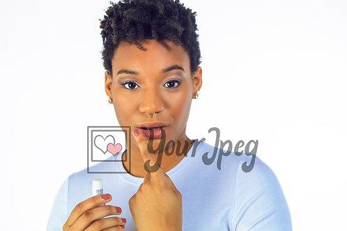 Woman rubbing balm on lip