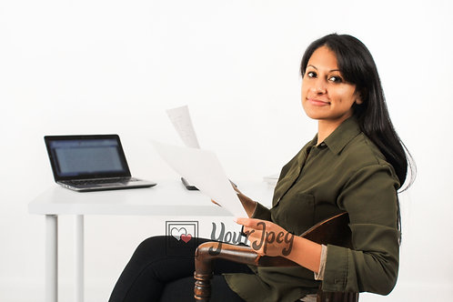 Woman Holding Papers While Sitting At Desk