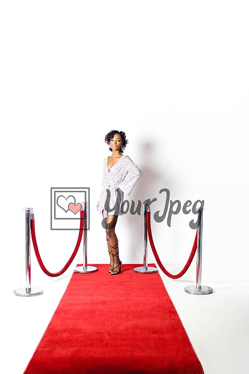 Woman Posing On Red Carpet With Her Hand On Her Hip