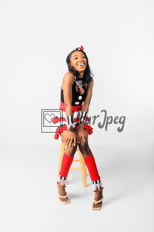 Woman Modeling In Costume Sitting On Stool Smiling #2