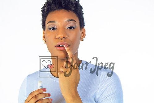 Woman touching top lip