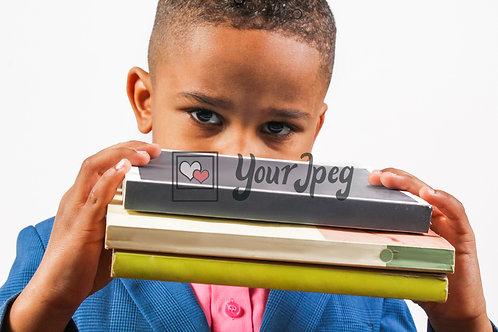Boy peeking over books