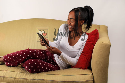 Woman Smiling While Looking Down and Holding Black Tablet
