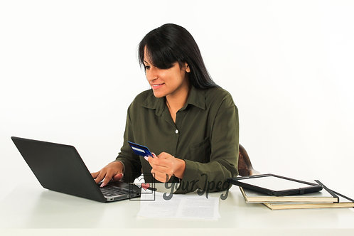 Woman Holding Credit Card While Looking At Laptop Smiling #2