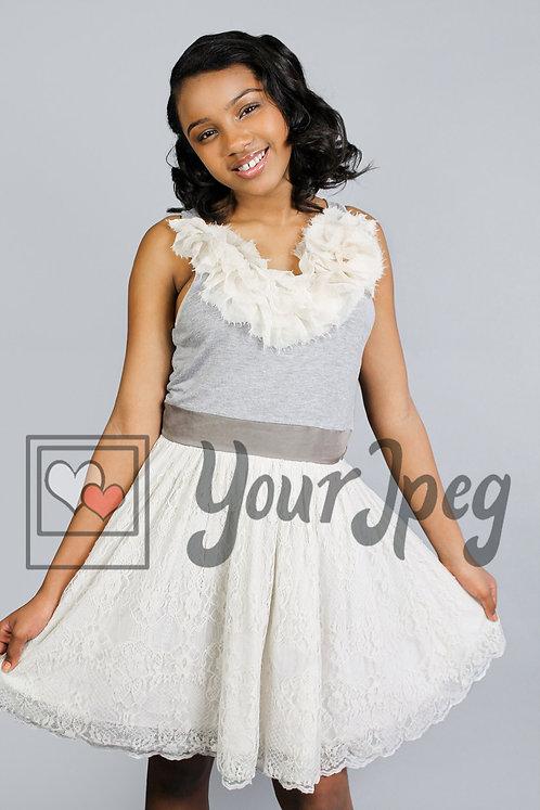 Teen girl wearing dress smiling