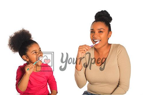 Brushing teeth with older sister