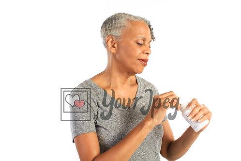 Older woman taking vitamins 2
