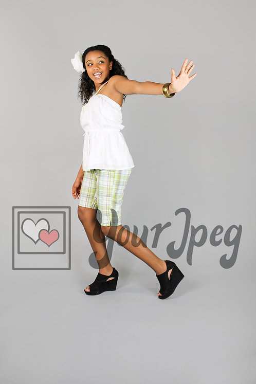 Tween girl holding hand up while walking