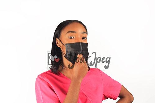 Female Nurse Adjusting Face Mask At Mouth