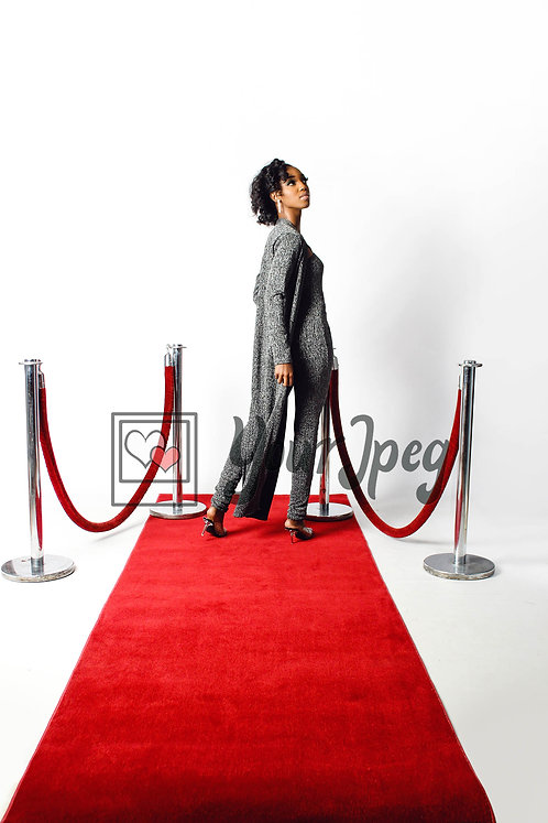 Woman Posing On Red Carpet While Looking Up Over Her Shoulder