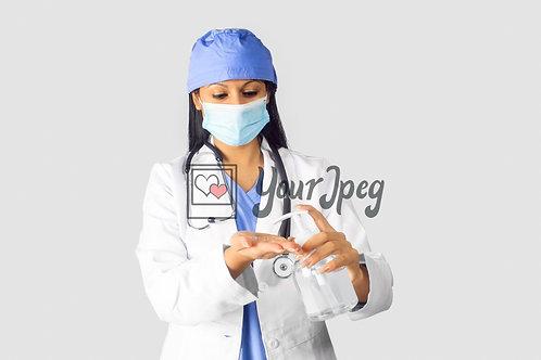Female Doctor Using Hand Sanitizer #2