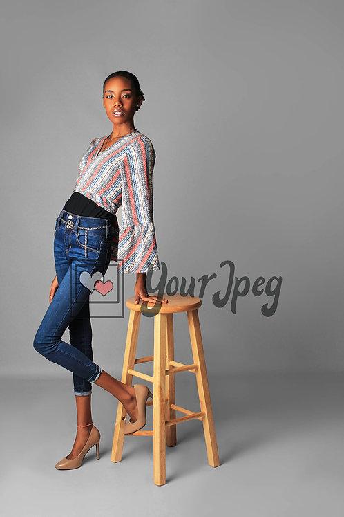 Model Leaning On Stool
