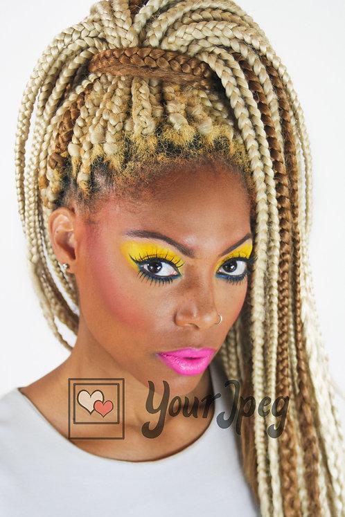 Headshot of woman with blonde braids